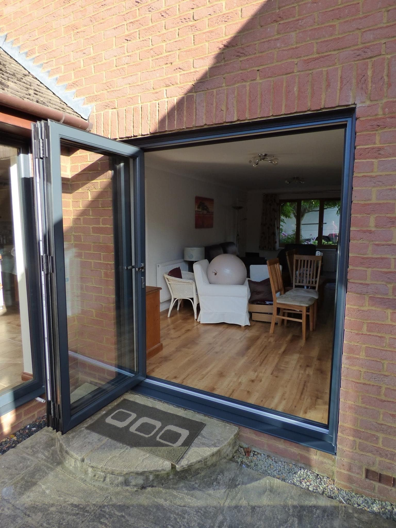 Patio doors being installed in Sibbaldbie