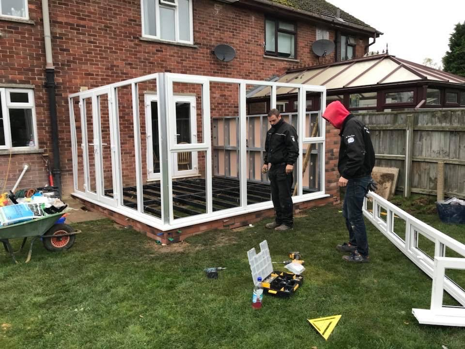 Patio doors being installed in Oxwich