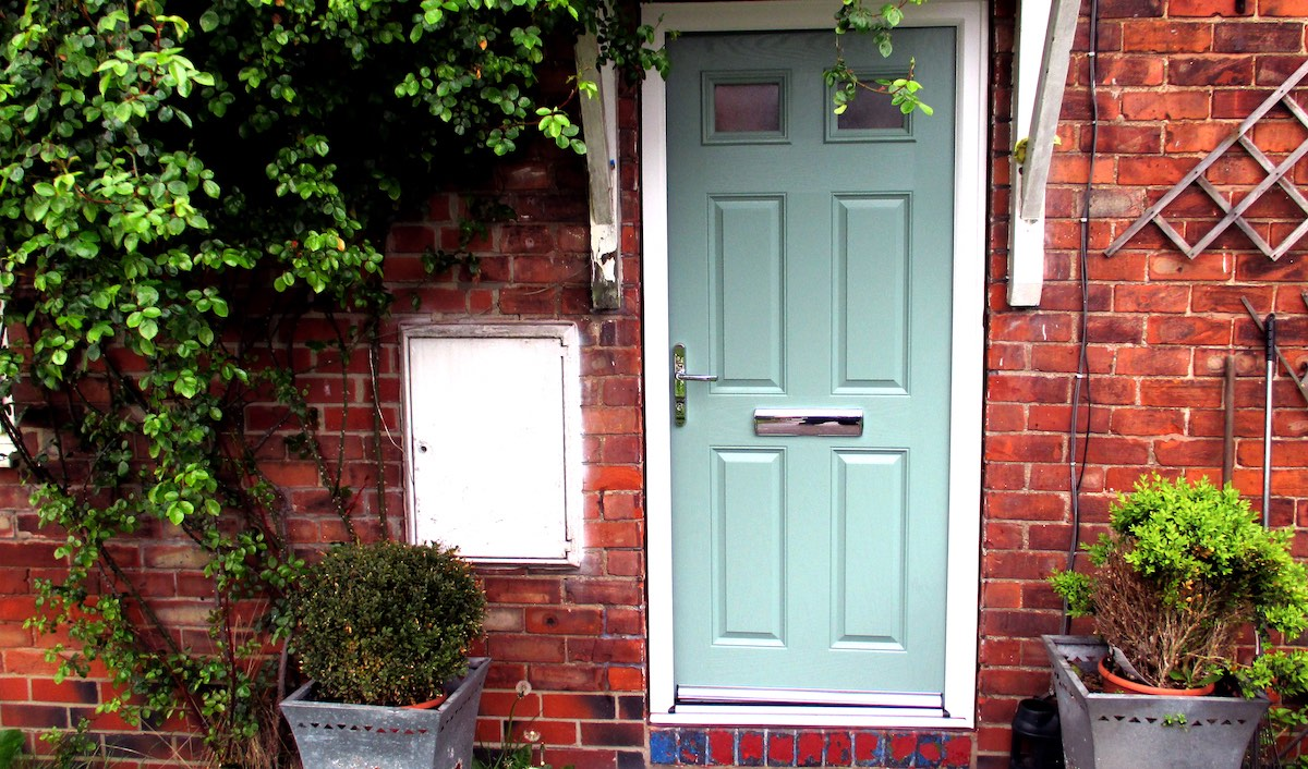 uPVC front door in Top O Th' Knowl