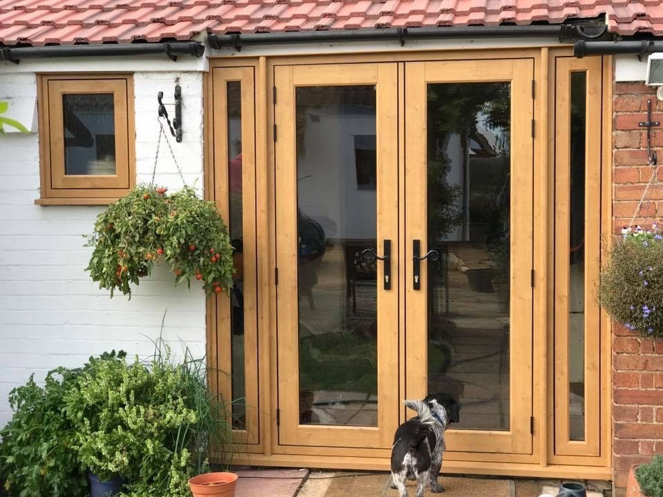 Patio doors being installed in Peasemore