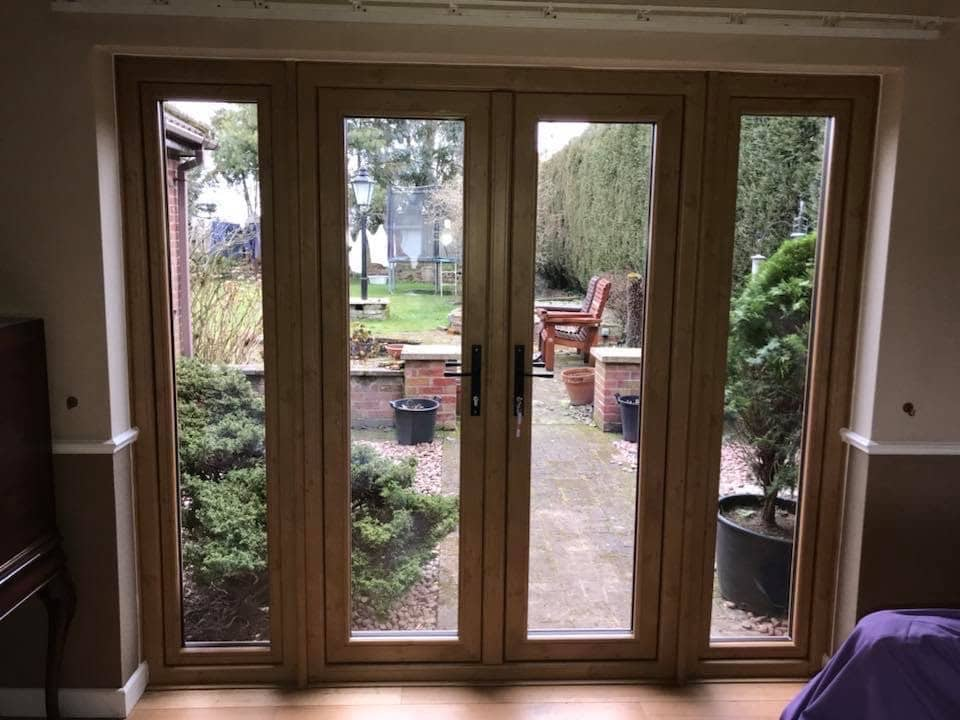Patio doors being installed in Netherhope